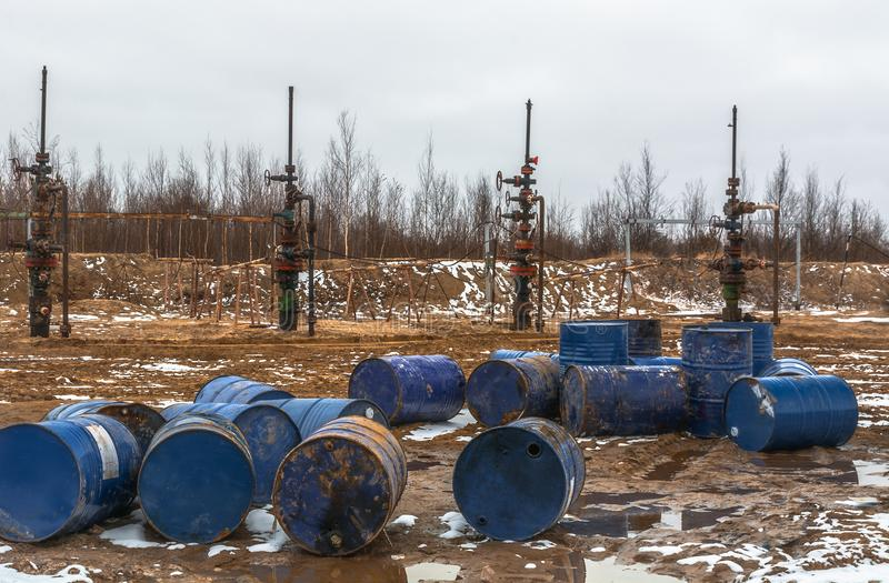 The oil is over. There is nothing to fill barrels. Empty barrels from the oil before the stopped oil wells. Ecological problem in the field royalty free stock images