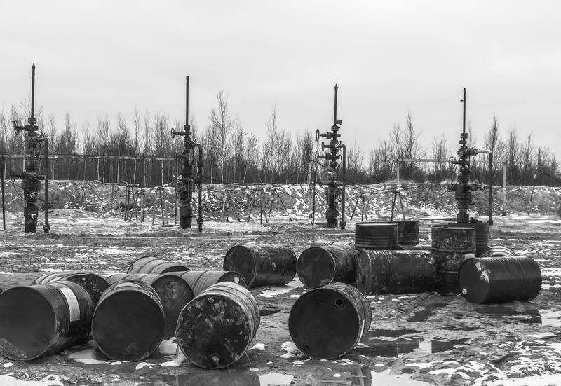 The oil is over. There is nothing to fill barrels. Empty barrels from the oil before the stopped oil wells. Ecological problem in the field royalty free stock photography