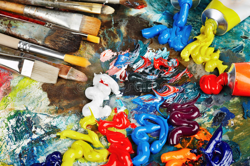 Oil paint and brushes. Palette with oil paint and brushes royalty free stock photography