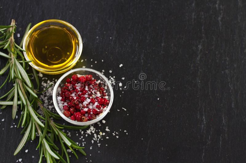 Oil with pepper. On black background stock image