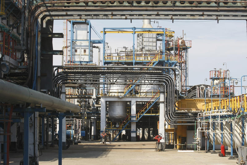Oil petrochemical refinery pipes. Oil petrochemical refinery with many pipes stock photo
