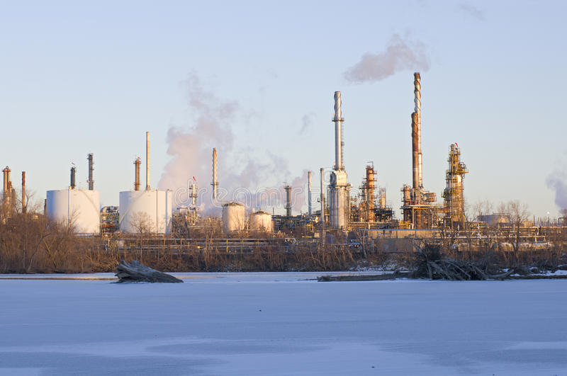 Oil and Petroleum Refinery Along Frozen Mississippi River royalty free stock photos