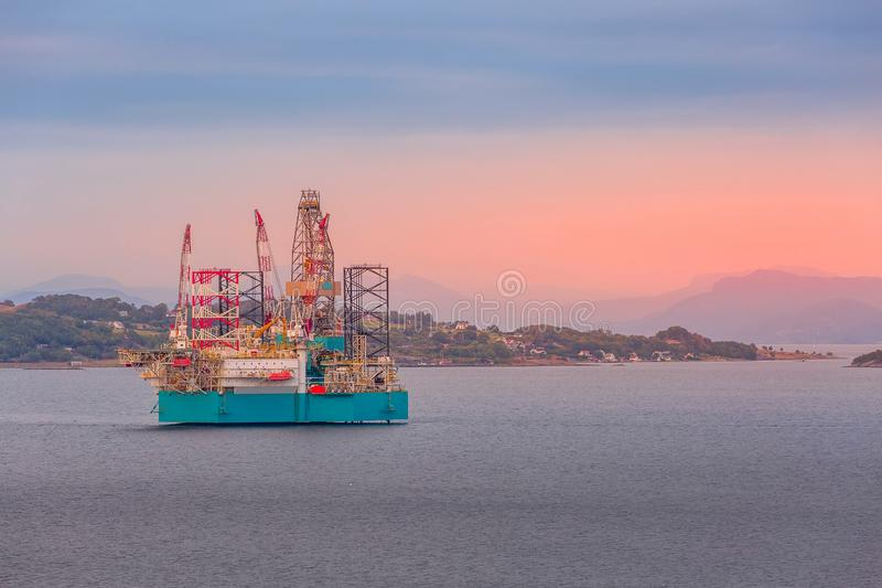 Oil platform in Norway, Stavanger. Oil rig, offshore platform in Stavanger, Norway fjord with copy space stock photo