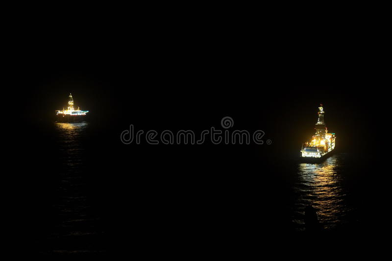 Oil platform and ship on the sea stock photography