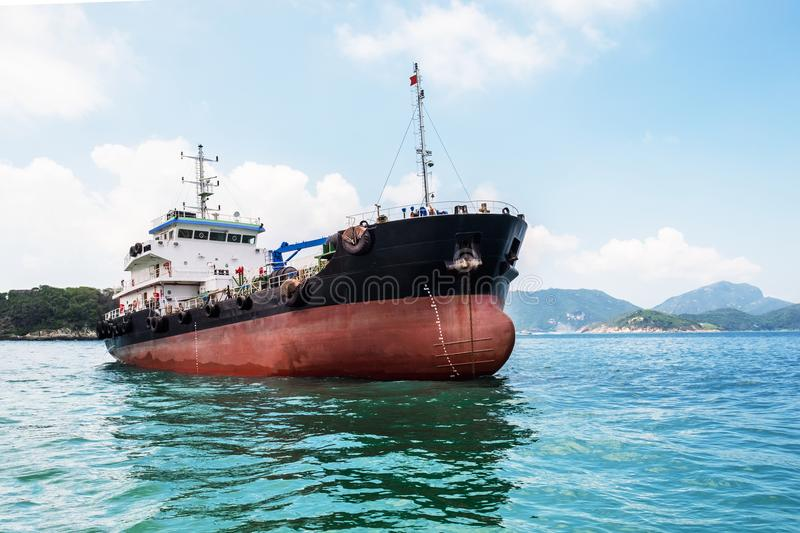 Oil product coastal tanker in South-China Sea, Pacific Ocean. Product coastal tanker at anchor on seascape background. Nautical vessel, container ship. Logistic royalty free stock photo