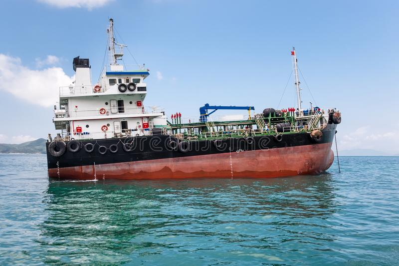 Oil product coastal tanker in South-China Sea, Pacific Ocean. Product coastal tanker at anchor on seascape background. Nautical vessel, container ship. Logistic stock photography