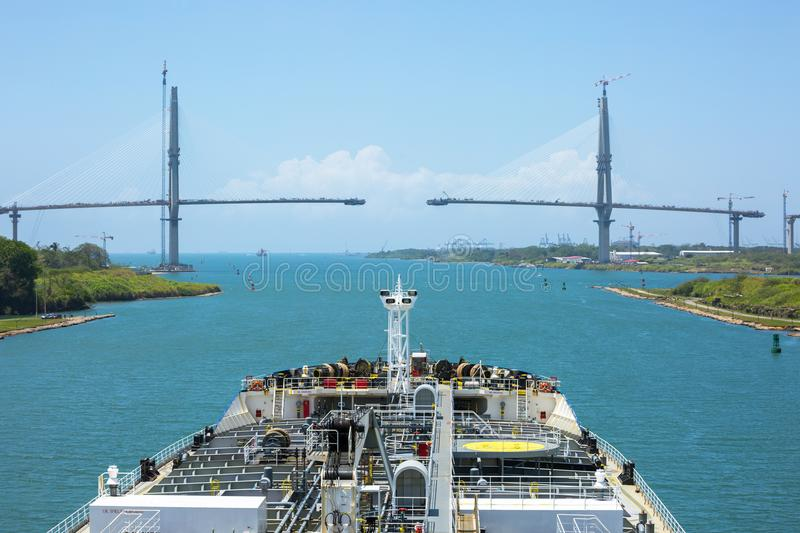 Oil product tanker entering to the Caribbean Sea under the bridge. Oil product tanker entering to the Caribbean Sea via Panama Canal under the bridge royalty free stock image