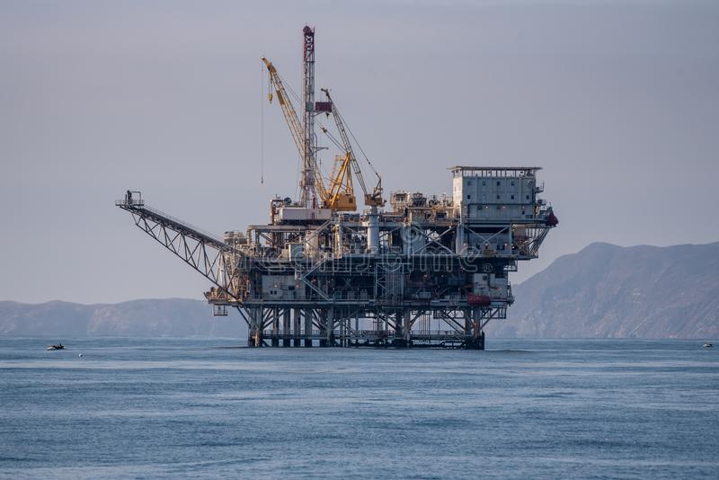 Oil production taking place in middle of ocean. stock image