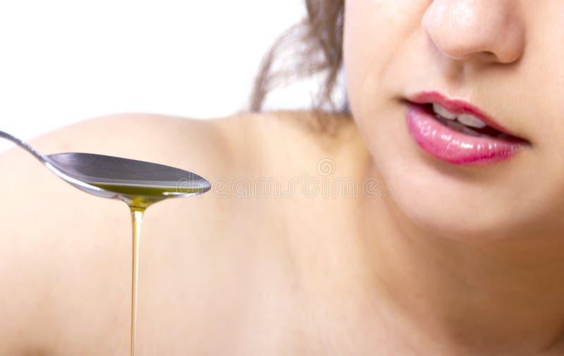 Oil Pulling / Swishing. Trending oral health practice of Oil Pulling or Swishing stock image
