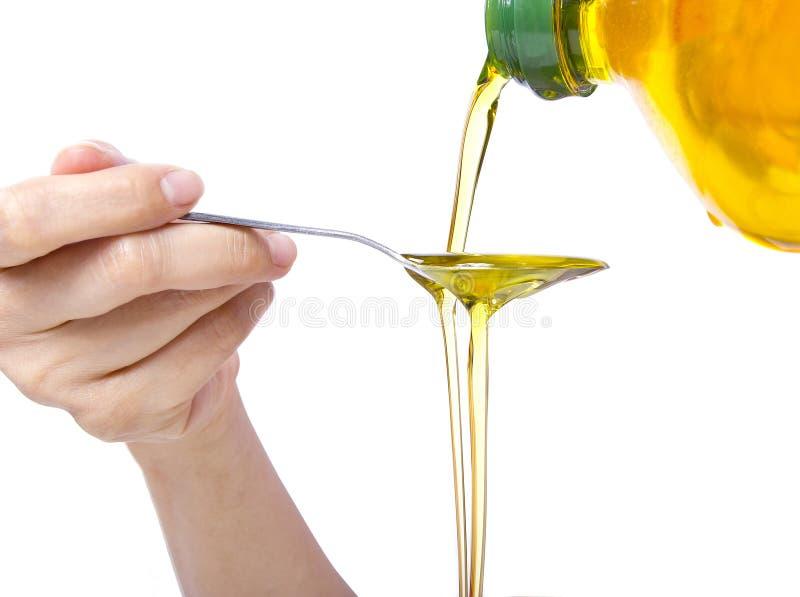 Oil Pulling / Swishing. Trending oral health practice of Oil Pulling or Swishing stock photo