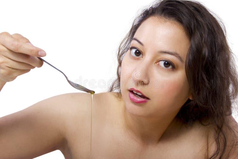 Oil Pulling / Swishing. Trending oral health practice of Oil Pulling or Swishing royalty free stock images