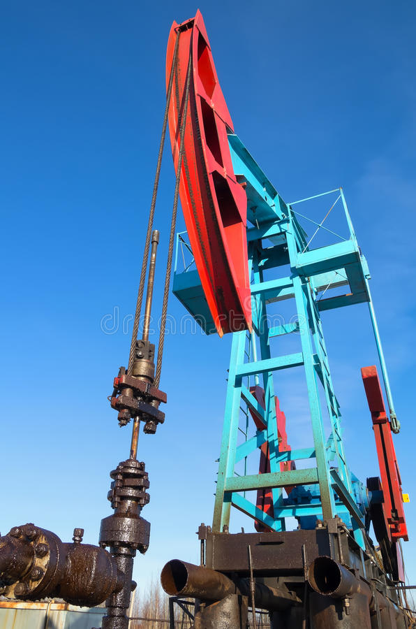 Oil pump. Extraction of minerals by means of the oil pump is rocking royalty free stock image