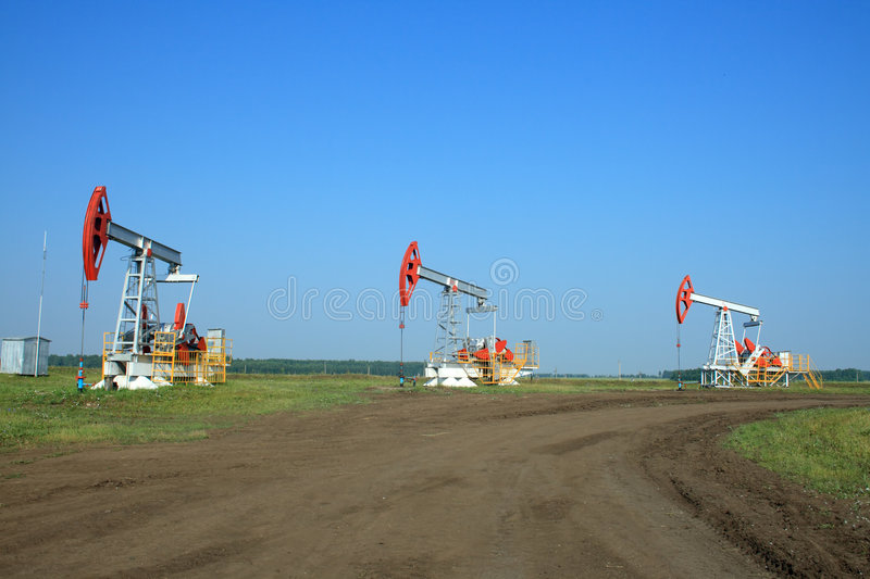 Oil Pump Jack In a field stock images
