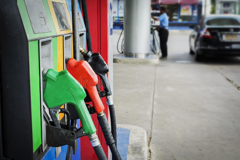 Oil pump nozzles Gas stations. Oil pump nozzles in Gas stations stock photos