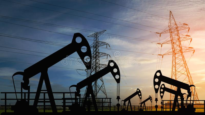 Oil pump oil rig energy industrial machine for petroleum in the sunset stock photo
