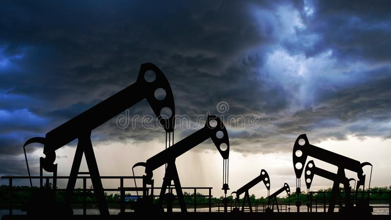 Oil pump oil rig energy industrial machine for petroleum in the sunset stock photography