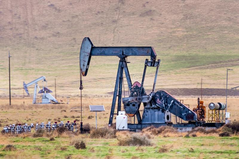 Oil pump operating on the Kern County petroleum field, Bakersfield, California royalty free stock photography