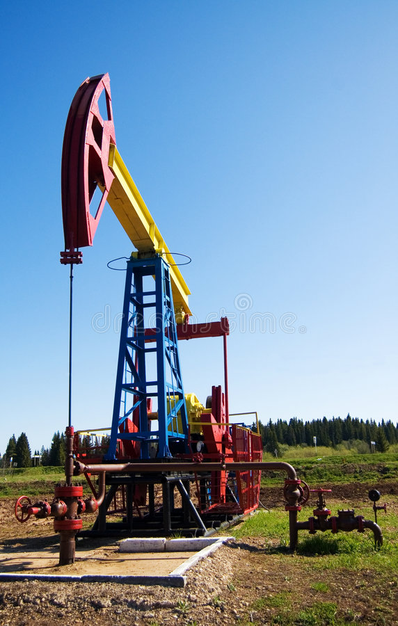 Oil pump with sky copyspace royalty free stock image