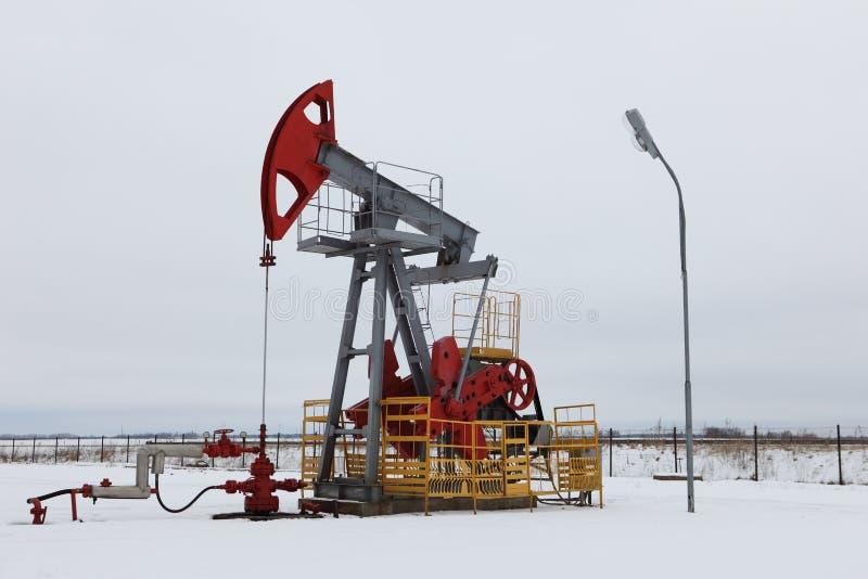 Oil pump in winter stock photos