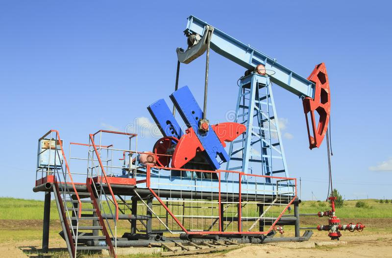 Oil pump are working in the blue sky stock images