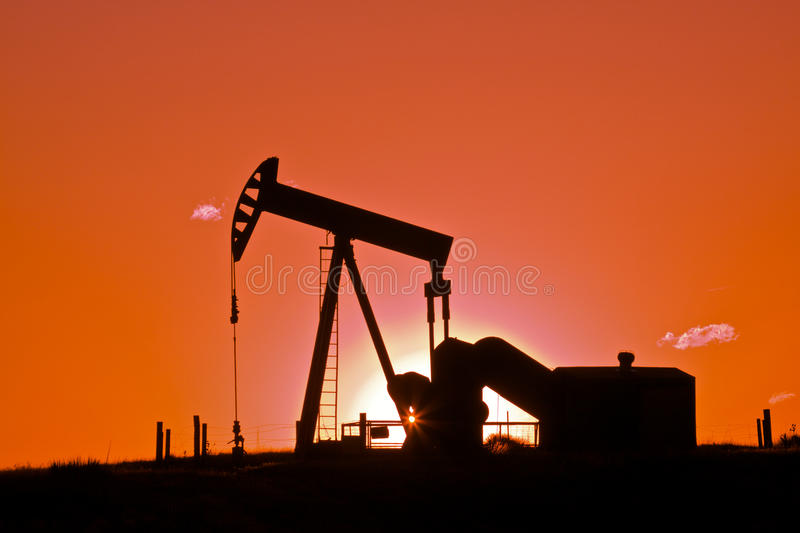 Oil Pumpjack in Sunset stock image