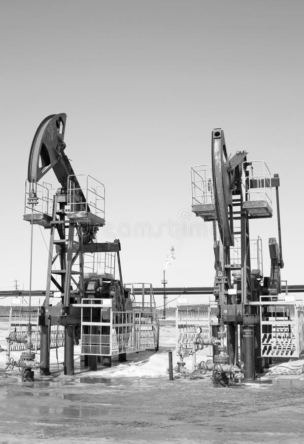 Oil pumps. Gas and oil industry royalty free stock photo