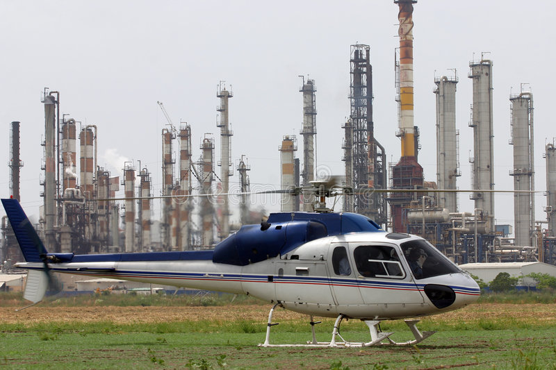Oil refineries & helicopter royalty free stock images