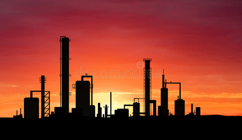 Oil refinery. Factory over sunrise royalty free stock photo