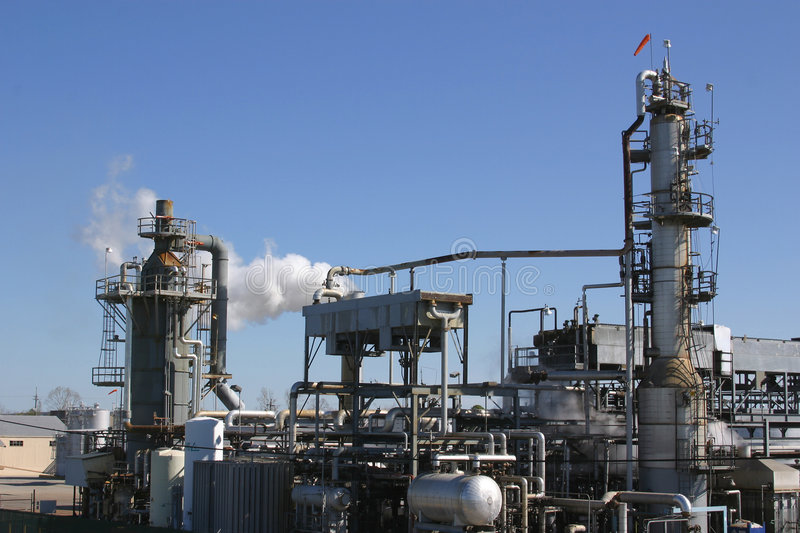 Oil Refinery. Image of an oil refinery against a clear blue sky background stock photography