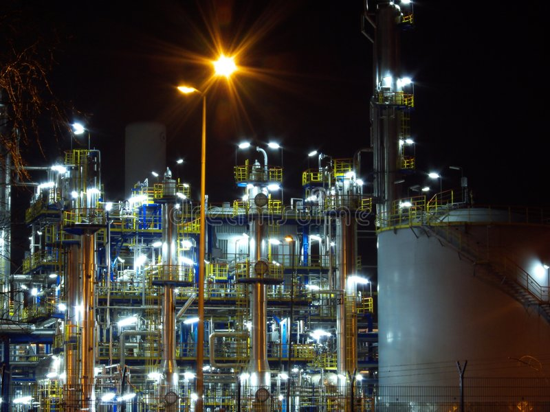 Oil refinery. Night oil refinery, night scene, light and oil refinery construction stock photo