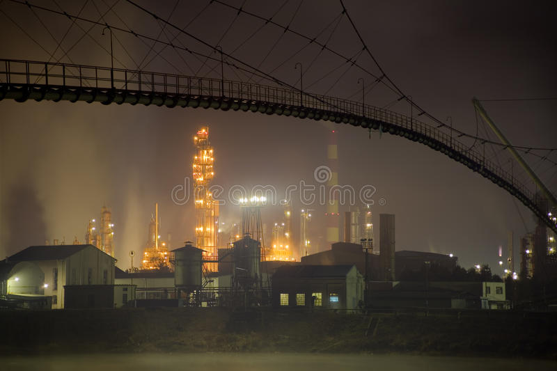 Oil refinery. Smog production by oil refinery stock photos