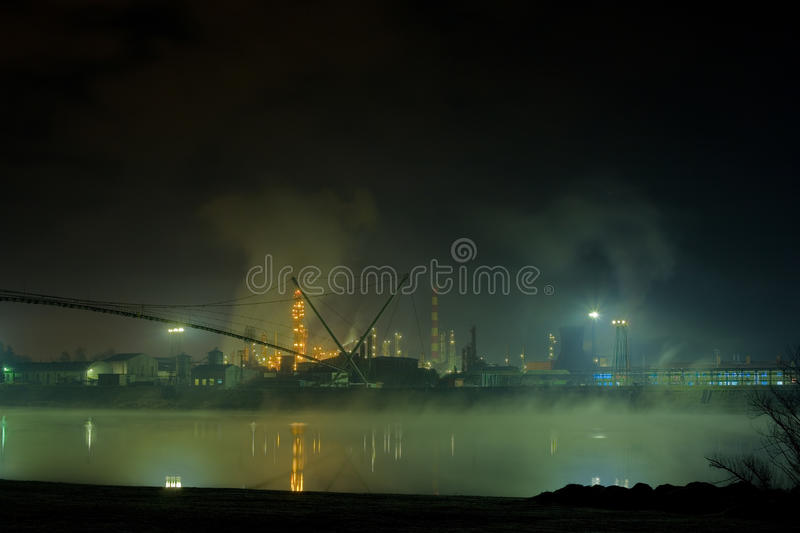 Oil Refinery. In it own mist royalty free stock photo