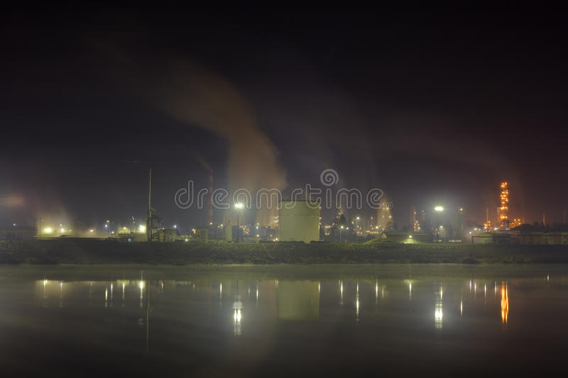 Oil refinery. Air and water pollution by oil refinery royalty free stock image