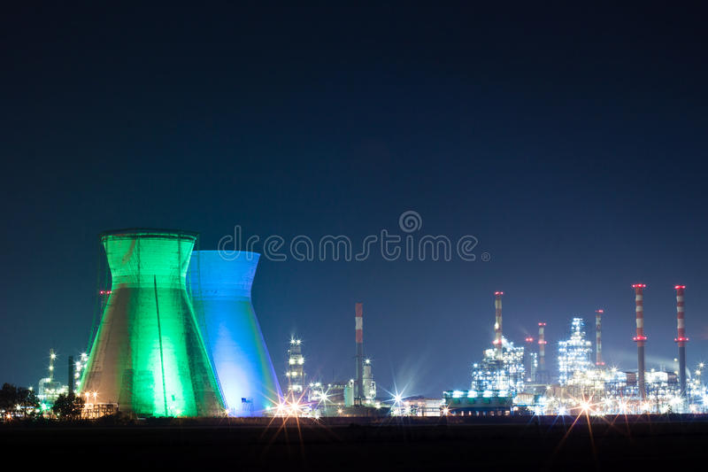 Oil refinery. Colored lights at night royalty free stock image