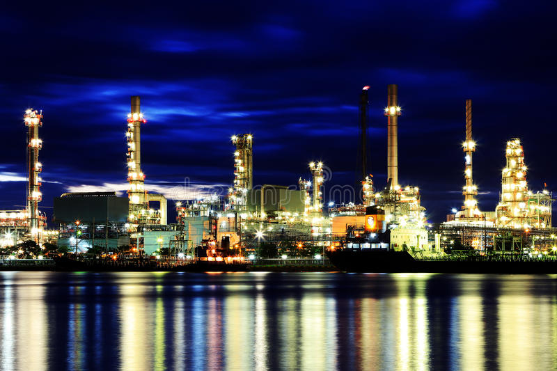 Oil refinery. At twilight in Thailand royalty free stock photos