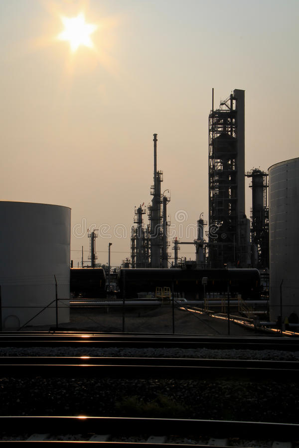 Oil Refinery. Imaghe of an oil refinery taken shortly before sunset with the sun behind the towers stock photos