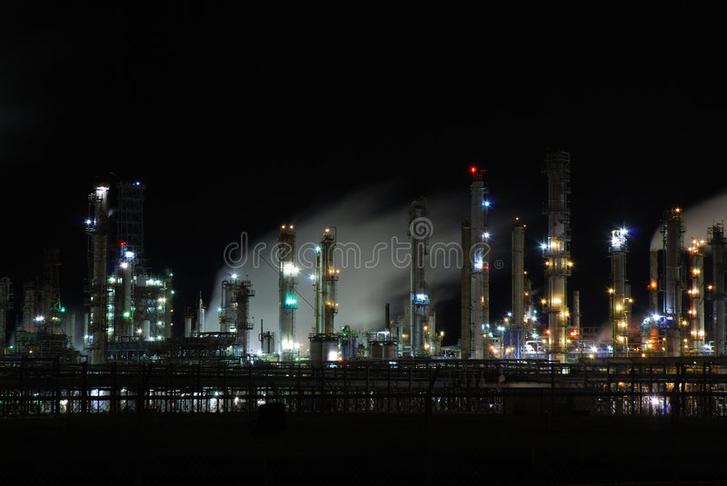 Oil refinery. Illuminated at night royalty free stock images