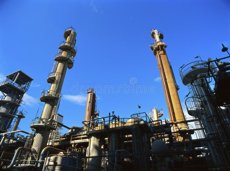 Oil refinery. Towers at an oil refinery royalty free stock photography