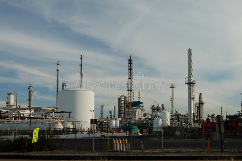 Oil Refinery. An oil refinery sits idle on a weekend day royalty free stock photo