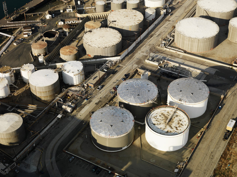 Oil refinery aerial. Aerial view of liquid storage tanks in Los Angeles California oil refinery stock photography