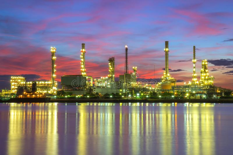 Oil refinery. Along the river at sunrise time, Bangkok, Thailand stock photography