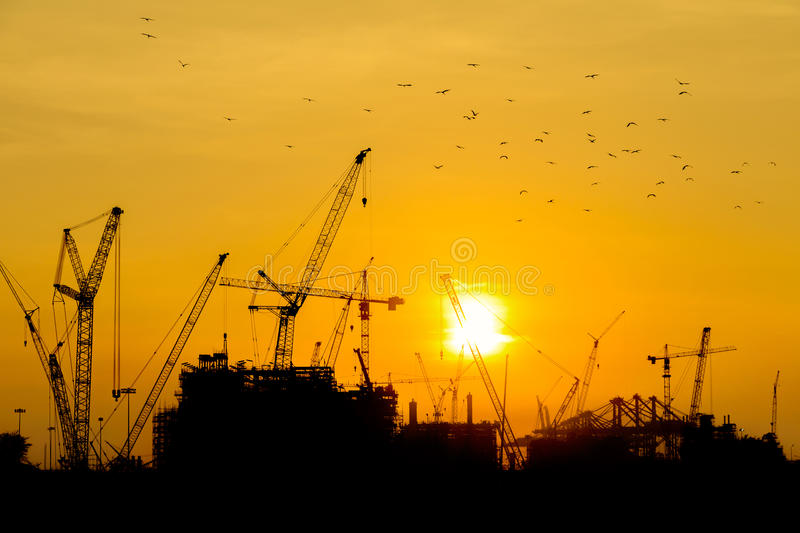 Oil refinery construction. In silhouette royalty free stock photo