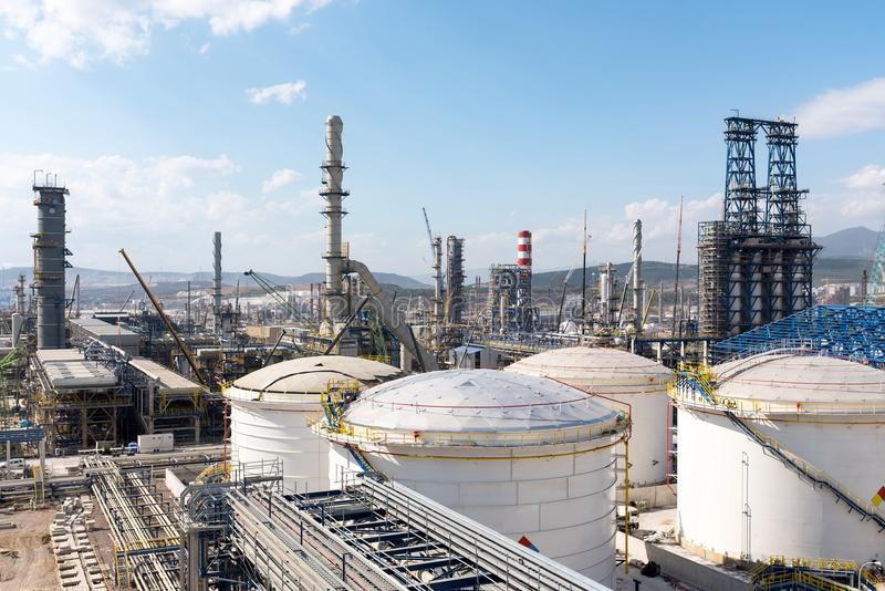 Oil Refinery Construction Site View. With Cranes And Various Equipment royalty free stock photography