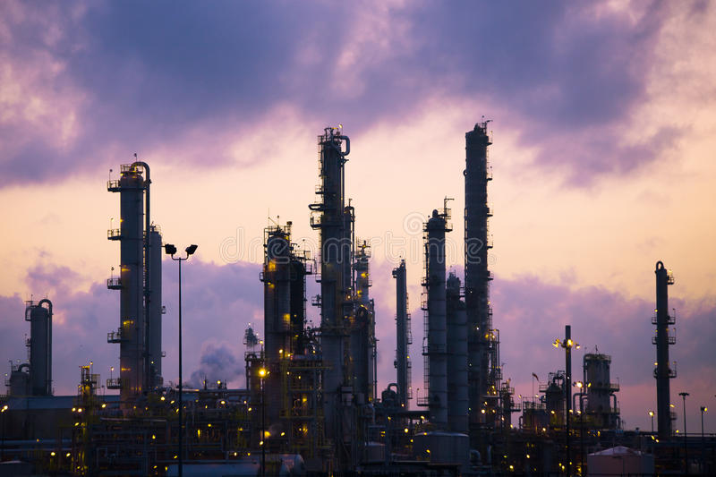 Oil Refinery at Dawn. Exhaust pipes from the Imperial Oil refinery in Sarnia. Shot in the morning just before sunrise stock photography