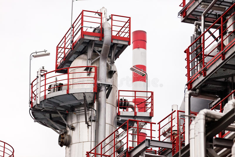 Oil refinery. Detail of oil pipeline with valves in large oil refinery royalty free stock photo