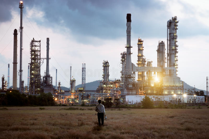Oil refinery. Engineer standing at Oil refinery stock images