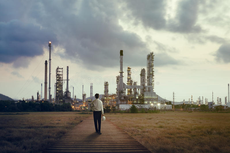Oil refinery. Engineer standing at Oil refinery, Power and energy crisis concept stock photos