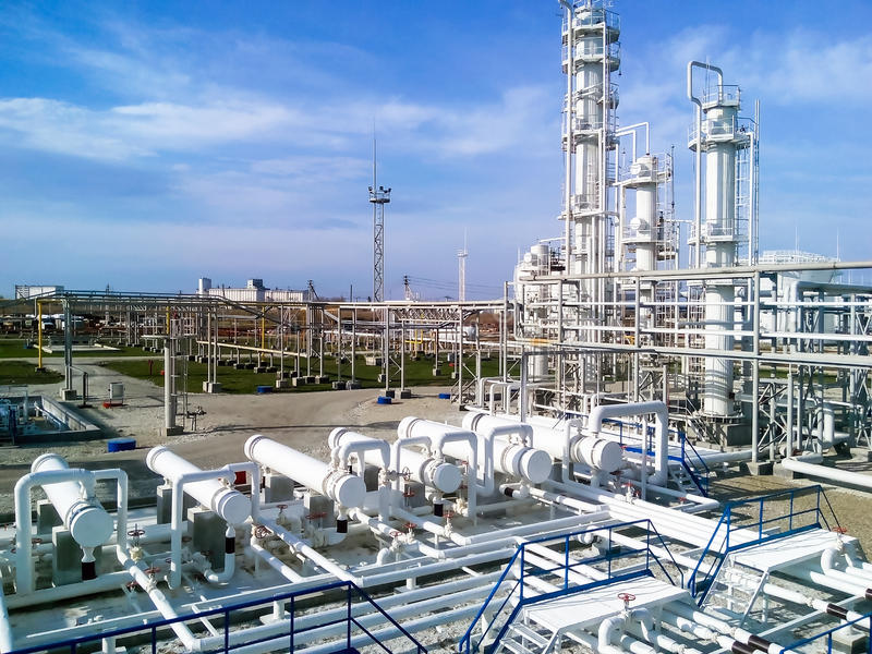 The oil refinery. Equipment for primary oil refining stock images