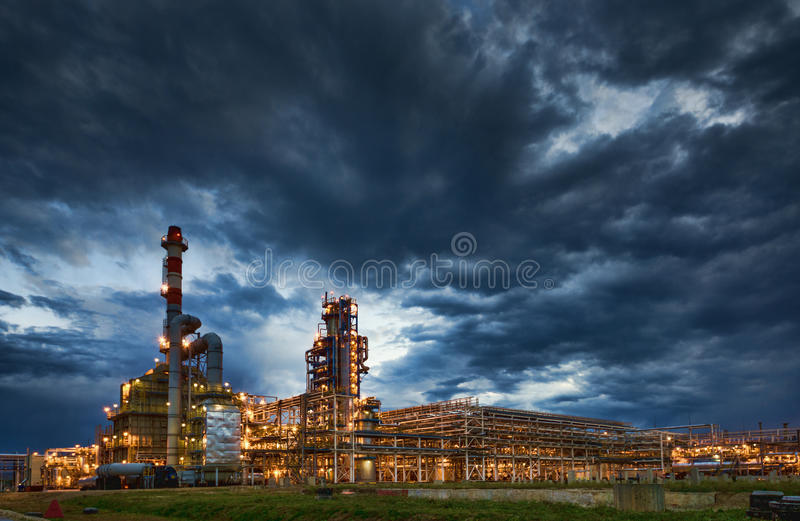 Oil Refinery At evening stock image