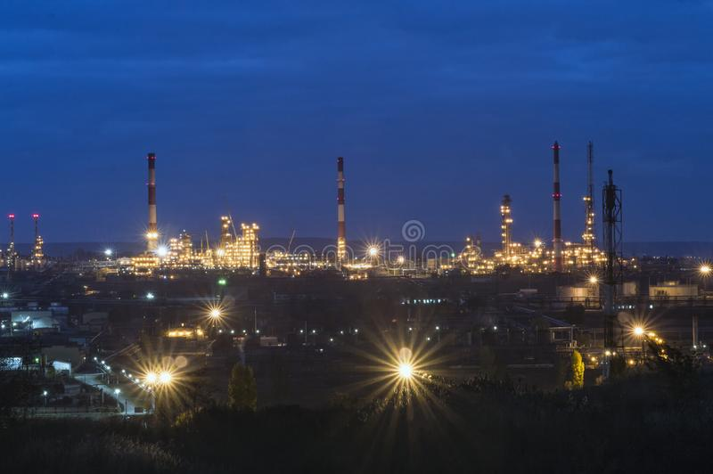 Oil refinery. In the evening, under artificial lighting royalty free stock images